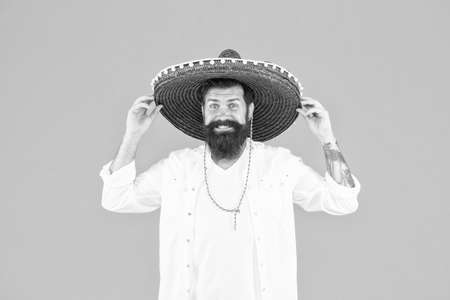 Mexican man wearing sombrero. Guy in wide brim hat. Ethnic concept. Ethnic background. Ancestry language and cultural traditions. Discover ethnic and geographic origins. Bearded man in mexican hat