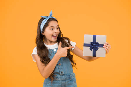 Perfect day. shopping online delivery. cheerful kid open wrapped box. best resent ever. gift she expected. small girl customer pointing finger gift. happy holiday celebration. birthday party surprise