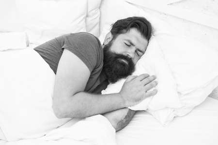 Peaceful morning. early morning. getting the rest your body needs. bed is so comfortable. peaceful mature male relaxing. bearded man sleeping in bed. sleepy guy relax in bedroom Standard-Bild