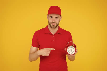 do you have time. time management concept. what time is it. countdown. deadline and discipline. punctual delivery man. on-time delivery. man in uniform hold alarm clock. Moving Office Service
