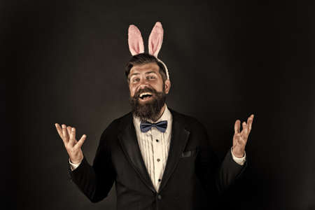 Celebrating spring equinox. Happy businessman black background. Bearded man smile with bunny ears. Enjoying Easter party. Pleasure and fun. Spring season. Springtime. Spring holidays. Spring is here