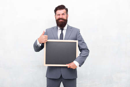 Try the best product. Happy man recommend product. Salesman give thumbs up gesture. Product promotion. Promoting and marketing. Product for sale. Empty blackboard, copy space