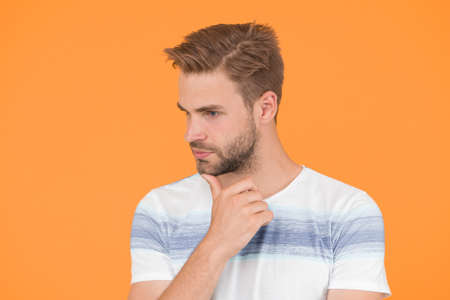 Pensive face. Man serious face thoughtful. Have some doubts. Thoughtful expression. Find solution. Thoughtful man on yellow background. Hipster bearded face not sure in something. Hard question