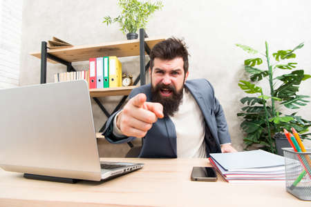 Angry boss. feeling so angry. Angry businessman. Furious mature man pointing finger on you. Blaming each other. Brutal businessman in office. Mature bearded hipster use computer. Male boss working