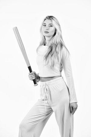 female cricket player. girl ready batting ball. Sport and sportswear fashion