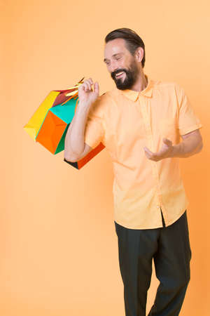 It is bargain. Bearded man with shopping bags. Happy holidays. shopping. big sale in shopping mall. Mature hipster with beard. brutal caucasian hipster with moustache. Incredible time while shopping