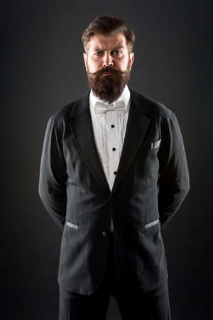 Well dressed and scrupulously neat. Hipster formal suit tuxedo. Official event dress code. Male fashion. Classic style. Classic never out of trend. Menswear classic outfit. Bearded man with bow tie Stock Photo