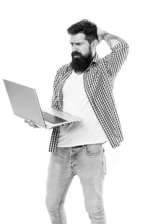 Laptop is his flexible friend. Anxious hipster with thoughtful bearded face holding laptop. Professional laptop computer repairman or tech worker. Bearded man looking at his laptop Stockfoto