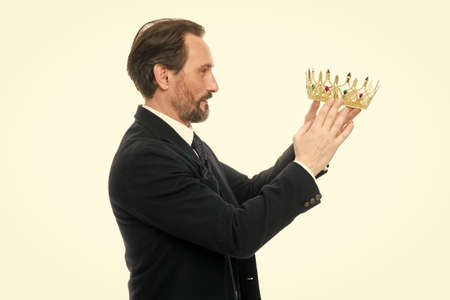 King attribute. Become next king. Monarchy family traditions. Man nature bearded guy in suit hold golden crown symbol of monarchy. Direct line to throne. Enormous privilege. Become king ceremony