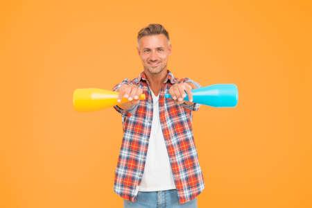Man spray disinfectant liquid around himself, spirit sanitizer concept