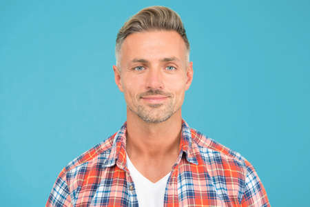 This is what man wants to look like. Caucasian man on blue background. Handsome man in casual fashion. Man with unshaved mustache beard and stylish haircut. Grooming salon. Barbershop
