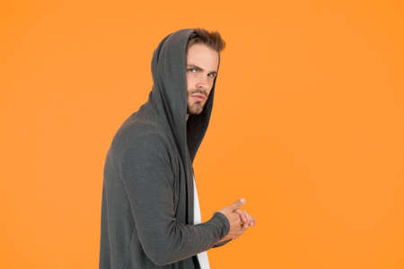 I will be back. Comfy garment for daily life. Fashion man yellow background. Fashion look. Handsome guy wear fashionable mantle with hood. Casual menswear. Fashion trends. Modern clothes for youth Stock fotó