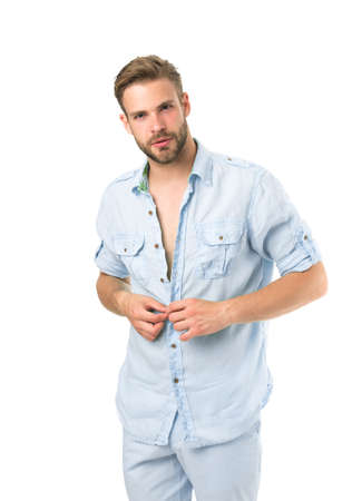It is hot here. Man handsome bearded guy undressing white background isolated. Guy confident attractive macho feels while unbuttoning shirt. I will show you my body. Want to see torso Stock fotó