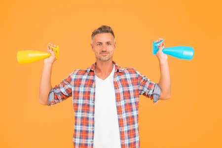 Man spraying disinfectant sanitizer around himself, cleaning day concept Stock Photo