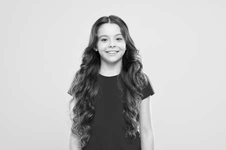 Little girl grow long hair. Teen fashion model. Styling curly hair. Change you can see. Hairdresser tip. Kid girl long healthy shiny hair. Perfect curls. Kid cute face with adorable curly hairstyle