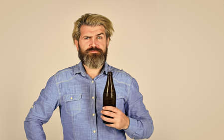 Sparkling water drink. Cold beverage. Drinking beer good for your mood. Making Homemade Kombucha. Refreshing lemonade. Soda drink. Hipster at bar. Man beard and mustache hold bottle. Alcohol drink Фото со стока