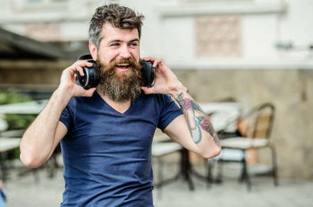 Free online music sources. Music is what I am. handsome bearded man in headphones listening song. Searching for favorite music. Style and music. Enjoying the rhythm of his life Imagens