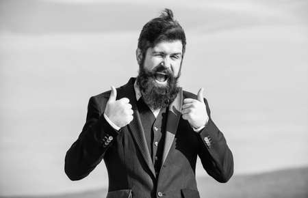 Thumbs up gesture. Man bearded optimistic businessman wear formal suit sky background. Success and luck. Optimistic mood. Think like optimist. Being optimistic. Hopeful and confident about future