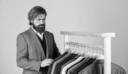 In search of inspiration. bearded man tailoring clothes. formal and office wardrobe. businessman. confident tailor designing male jacket. handsome sartor with tape measure. male beauty and fashion Standard-Bild