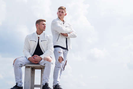 young twin brothers with similar appearance, fashion