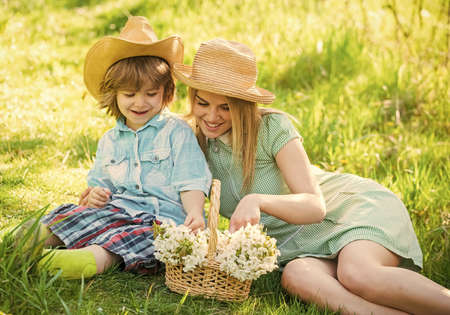 Mother and cute son having fun. Spring holiday