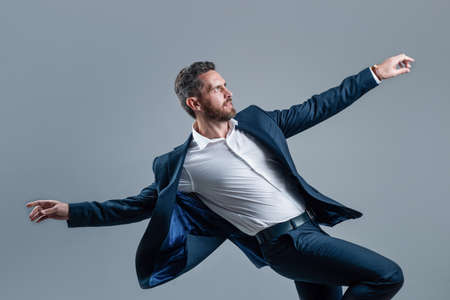happy businessman wearing suit dancing in office celebrating corporate party, celebration success