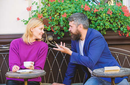 Couple terrace drinking coffee. Casual meet acquaintance public place. Romantic couple. Normal way to meet and connect with other single people. Meet become acquaintances. Meeting people first date