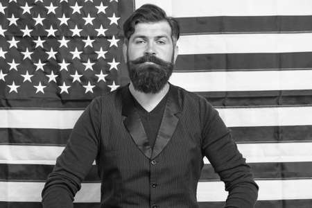 confident mature man at american flag. bearded man study english. fourth of july. independence day. celebration of freedom. patriotic education. legal system in america. Liberated in every way Stock Photo