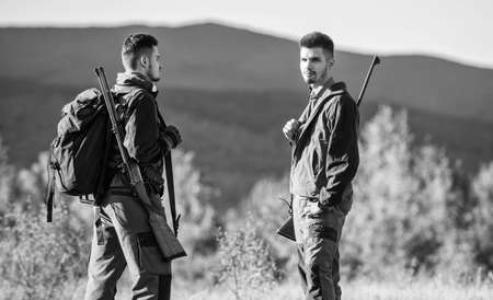 Hunting skills and weapon equipment. How turn hunting into hobby. Friendship of men hunters. Army forces. Camouflage. Military uniform fashion. Man hunters with rifle rifl gun. Boot camp. travel