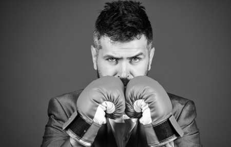 Businessman wear boxing gloves. Best criminal defense lawyer strategies. Attack and defense concept. Achieve success. Tactics proven to work. Criminal defense lawyer planning out strategies