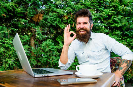 ok. brutal bearded hipster at coffee break. agile business. Business success. perfect deal. office worker. Successful businessman. happy man work on laptop. Business and entrepreneurship concept
