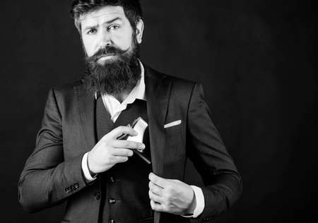 Bearded man drink alcohol. brutal caucasian hipster has bad addiction, alcohol. businessman in suit. bachelor and single. Mature hipster with beard put flask in pocket. alcohol srinking. copy space