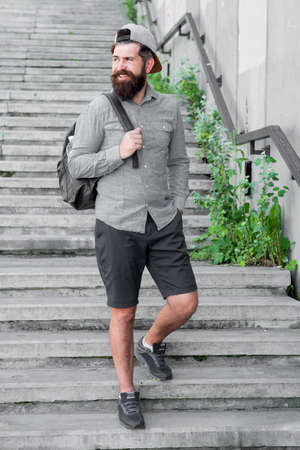 I love New York. Mature hipster with beard traveller. Bearded man. Confident brutal man walk street. Male barber care. brutal hipster with travel backpack. hiking adventure concept. urban style Archivio Fotografico