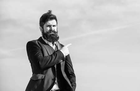 This way. Changing course. Looking for opportunities and chances. Man formal suit manager looking direction. Developing business direction. Businessman bearded face sky background. Business direction
