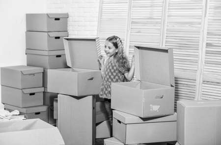 happy little girl. Cardboard boxes - moving to new house. Moving concept. new apartment. purchase of new habitation. happy child cardboard box. Unbeatable Location