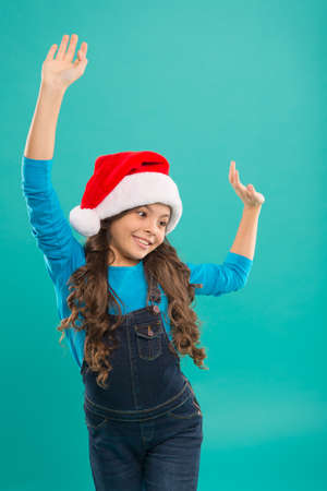 Present for Xmas. Childhood. Christmas shopping. New year party. Santa claus kid. Little girl child in santa hat. Happy winter holidays. Small girl. Bright memories. Come Santa Clause and don t delay Stock Photo