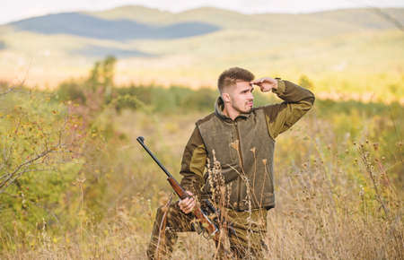 Hunter hold rifle. Focus and concentration of experienced hunter. Hunting and trapping seasons. Man brutal gamekeeper nature background. Hunting permit. Bearded hunter spend leisure hunting Foto de archivo
