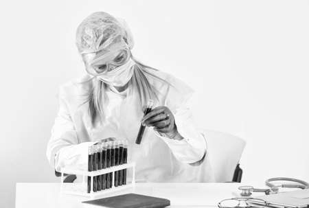 Scientist working with blood sample in laboratory. female doctor doing experiment. Laboratory analysis. make virus test. pandemic outbreak. Medical equipment. Blood test