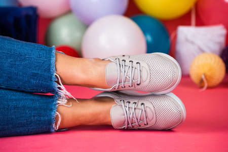 shoe care. black friday shopping. female feet in shoes with balloons. just having fun. Standard-Bild