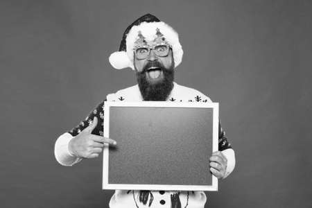 Promoting winter goods. Profitable offer here. Rental services. Winter price drop. Bearded hipster Santa claus. Joyful man show blackboard copy space. Happy winter holidays. Presentation announcement