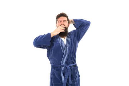 Feeling sleepy. Sleepy hipster yawn isolated on white. Bearded man look sleepy in bathrobe. Early morning time. Good night. Home clothing. Awakening. Being lazy and sleepy Foto de archivo