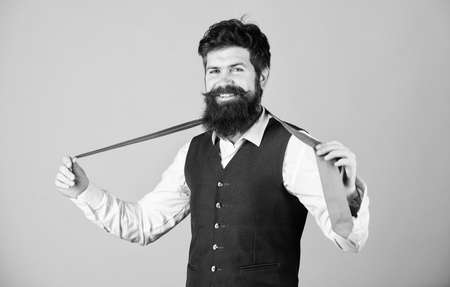Perfect tie. Fashionable man. Bearded man holding necktie. Brutal guy wearing fashionable classy clothes and accessory. Businessman in fashionable hipster style. Fashion model with fashionable look Reklamní fotografie