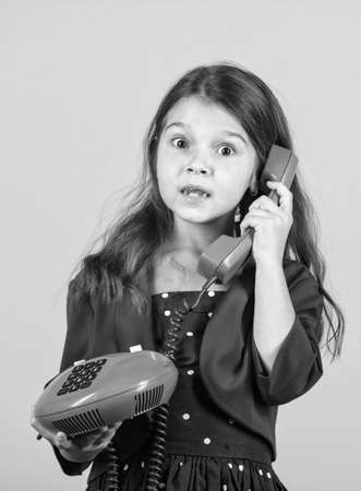 Surprising news. Little talker. Retro style. Communication concept. Shopping online. Retro girl speak phone. Kid talking vintage phone. Pinup girl conversation. Discuss gossip. Retro communications