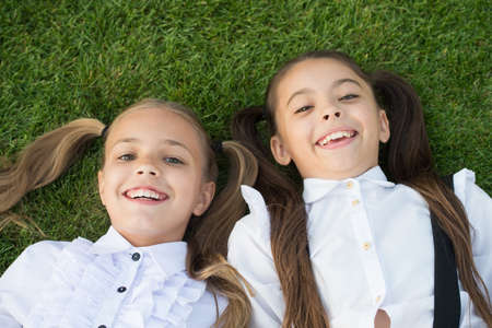 Happy childhood experience. Happy children relax on green grass. Enjoying childhood years. Childhood protection. Childcare center. Childhood happiness. International childrens day