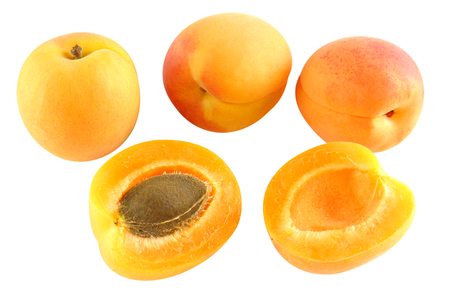 optional: Four apricots - one cut - optional Stock Photo