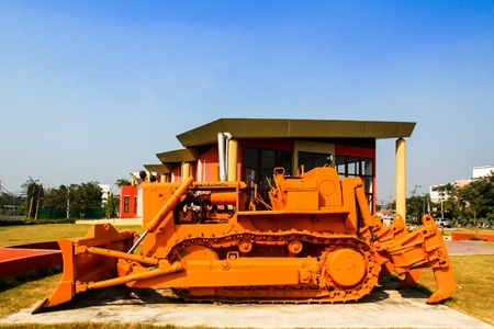 Orange bulldozer with blue sky photo
