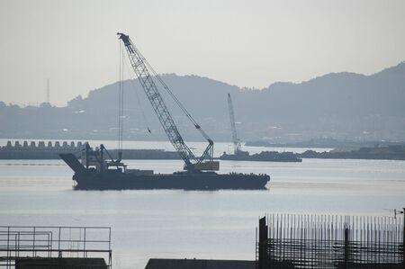 south asians: dredger. port scenes. jeju (cheju). south korea Editorial