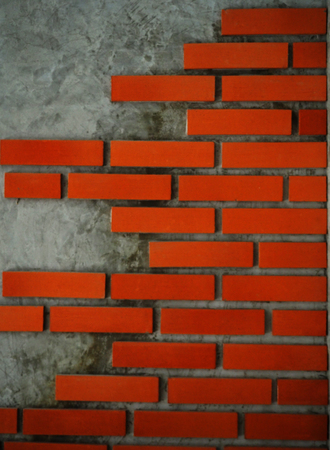 sidewall: The cement wall is partially covered by bricks. Hence there are some part which you can cement wall quite clear. It looks strange design for home decoration. Stock Photo