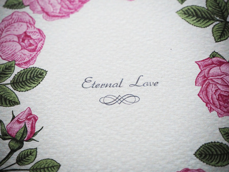 Eternal love is very romantic word which couple tell to each other. This photo was taken from wedding card. Beside the classic word, other detail of the card also showed loving of bride and groom. Stock Photo