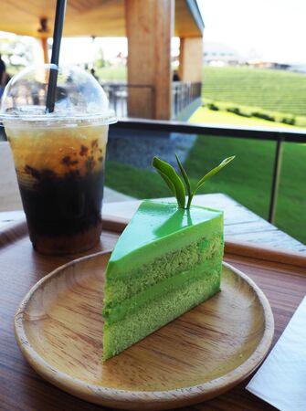 Green tea cake was served with Thai tea during tea time. This photo was taken at tea plantation in Thailand. Stock Photo